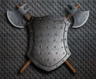 Metal spiked shield and two crossed battle axes on armor 3d illustration. Metal medieval fantasy shield and two crossed axes on armor Royalty Free Stock Photo