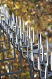 Metal spikes with autumn background 01 Stock Image
