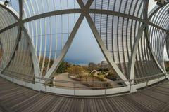 Metal spiral bridge in Madrid river, modern engineering. Park on the Manzanares River. In Madrid Spain stock images