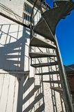 Metal spiral external stairs stock photography