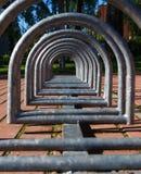 Metal spiral holder for bikes Stock Images
