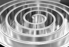 Metal spiral polished . Shallow depth of field. Stock Photo