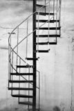 Metal Spiral Staircase. In an old building in black and white royalty free stock photos