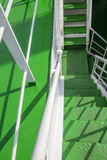 Metal spiral staircase built green. Stock Photography