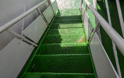Metal spiral staircase built green. Royalty Free Stock Photo