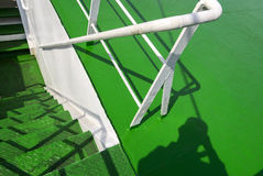 Metal spiral staircase built green. Stock Photo
