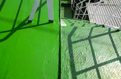 Metal spiral staircase built green. Royalty Free Stock Image