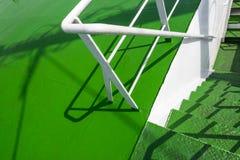 Metal spiral staircase built green. Stock Photos