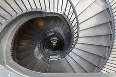 Metal spiral staircase. Gray metal spiral staircase as seen from the top of the stairs stock photography