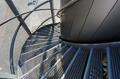 Metal spiral staircase near a modern building Royalty Free Stock Image