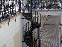 Metal spiral staircase. Openwork metal spiral staircase inside the building royalty free stock photos