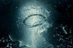 Metal splash II. Water splashing on stainless steel sink royalty free stock photos