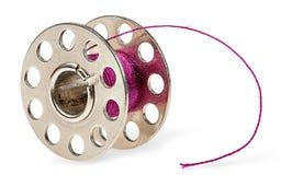 Metal spool with burgundy thread Stock Photography