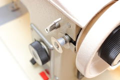 Metal spool of thread with sewing machine Stock Photo