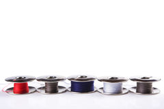Metal spools. Some metal spools with multicoloured threads isolated on white Stock Images