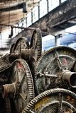Metal spools in deserted cotton factory Stock Photography