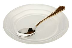 Metal spoon in a plastic plate Stock Image
