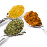 Metal Spoons With Spices Royalty Free Stock Photos