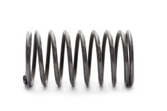 Metal spring. Dark metal spring laying isolated on white background Royalty Free Stock Photos