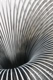 Metal spring, blurry details. Detail close up of metal spring, blurry details Royalty Free Stock Images