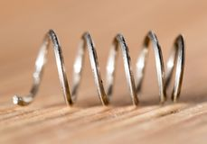 Metal spring. close-up. Photos in the studio Stock Images