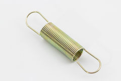 Metal spring. Close up metal spring on a white background Royalty Free Stock Photography