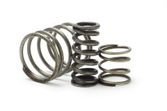 Metal spring coils. Three metal spring coils on white background Royalty Free Stock Photography