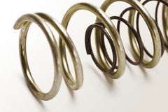 Metal spring coils. Of different sizes one inside another Stock Image
