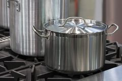Metal stainless steel pan. On a kitchen stove Royalty Free Stock Photo