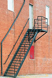 Metal stair fire escape on exterior of brick building Royalty Free Stock Photo