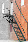 Metal stair fire escape on exterior of brick building Stock Photos