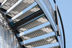 Metal staircase against a bright blue sky Stock Photos