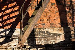 Metal staircase and brick wall stock photography