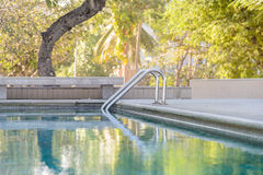 Metal staircase entrance to the pool Royalty Free Stock Photography