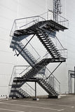 Metal staircase on fire exit at factory Stock Photography