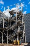 Metal staircase next to the building. New street metal staircase stock photos