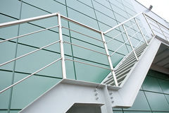 Metal staircase. Outdoor Metal staircase on the wall of modern industrial building Stock Images