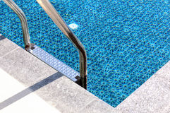Metal staircase to the swimming pool. Metal staircase to the entrance to the swimming pool Royalty Free Stock Photos
