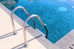 Metal staircase to the swimming pool. Metal staircase to the entrance to the swimming pool Stock Photography