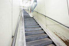 An metal staircase in a tunnel Stock Photo