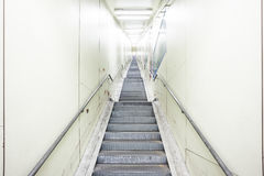 An metal staircase in a tunnel Royalty Free Stock Image