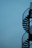 Metal stairs. Silhouette of metal escape stairs with a blue sky in the background stock photography