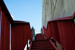 Metal stairs on the gray concrete wall Stock Photography