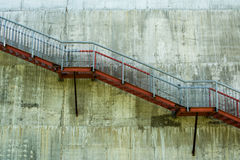 Metal stairs on the gray concrete wall.  Royalty Free Stock Image