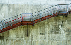 Metal stairs on the gray concrete wall.  Royalty Free Stock Photography