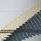 Metal stairs on the side of an industrial chemical container Stock Image