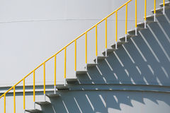 Metal stairs on the side of an industrial chemical container Royalty Free Stock Image