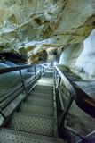 A colorful view of the ice cave in the glacier in slovakia. Metal stairs in the underground ice cave in the glacier in slovakia stock image