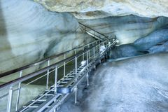 A colorful view of the ice cave in the glacier in slovakia. Metal stairs in the underground ice cave in the glacier in slovakia stock photography