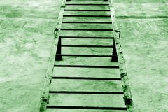 Metal stairway on cement wall in green tone. Royalty Free Stock Images